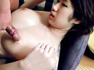 Large breast honey Huuka Takanashi is oiled up and her bra-stuffers fucked and creamed
